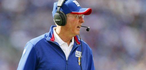 Giants head coach Tom Coughlin looks on against