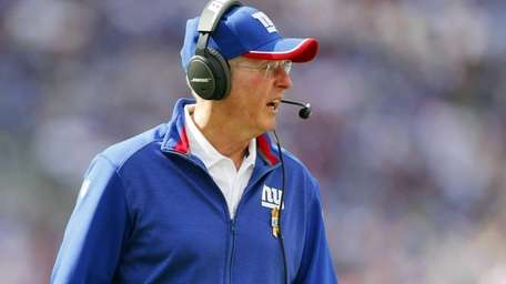 Giants head coach Tom Coughlin looks on against