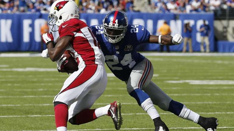 Walter Thurmond #24 of the Giants tackles John