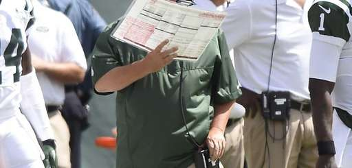 Jets offensive coordinator Marty Mornhinweg looks on during