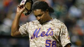 Jenrry Mejia #58 of the Mets walks to