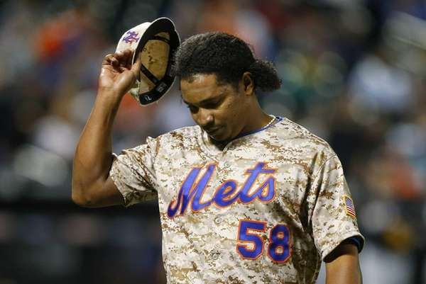 Jenrry Mejia of the Mets walks to the