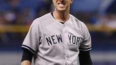 Yankees pitcher Chris Capuano reacts on the mound