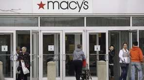Shoppers at Macy's in Braintree, Mass., on April
