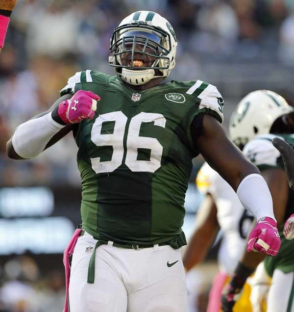 Defensive end Muhammad Wilkerson celebrates after sacking quarterback