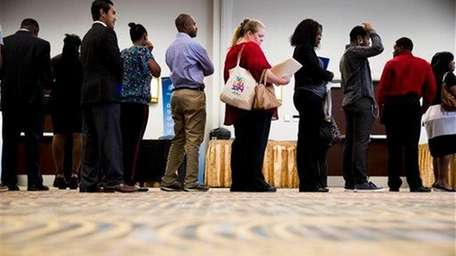 Job seekers are seen here waiting in line
