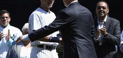 Yankees shortstop Derek Jeter greets Cal Ripken Jr.