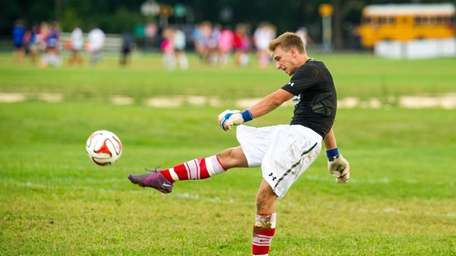 Half Hollow Hills West goalkeeper Tyler DeLucia clears