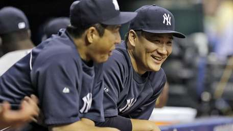 Yankees starting pitcher Masahiro Tanaka, right, talks to