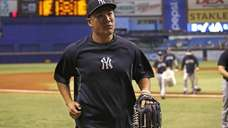 Pitcher Masahiro Tanaka of the Yankees runs from