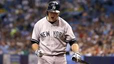 Brian McCann of the Yankees reacts as he