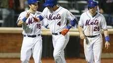 Wilmer Flores of the Mets celebrates his fifth-inning