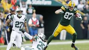 The Green Bay Packers' Jordy Nelson gets away