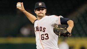 Nick Tropeano of the Houston Astros throws in