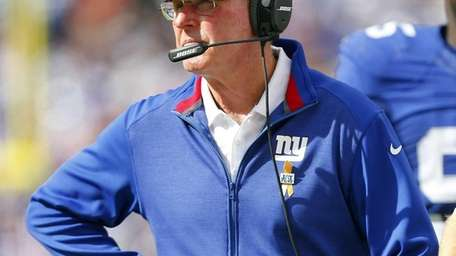 Giants head coach Tom Coughlin looks on after