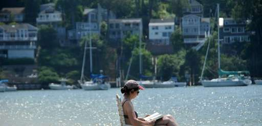 Helene Lach of Centerport reads by the shoreline