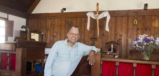Pastor Michael Smith, stands inside the Presbyterian Church