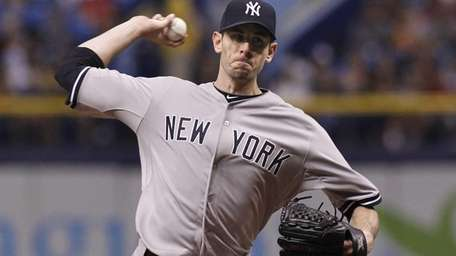 Brandon McCarthy pitches during the first inning of