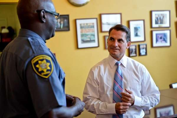 Suffolk Sheriff Vincent DeMarco, right, speaks with a
