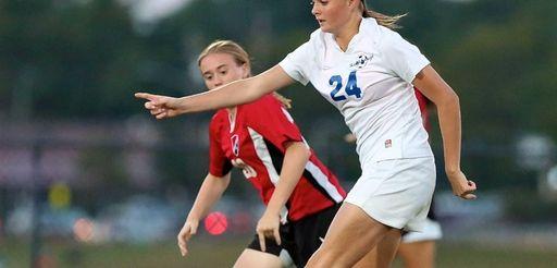 Hauppauge forward Keri McCarthy puts the shot on