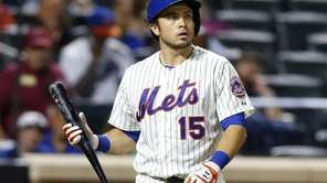 Travis d'Arnaud #15 of the Mets strikes out