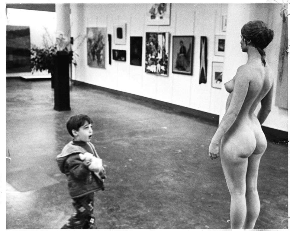 A little boy is stunned by the work