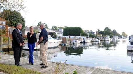 SPCA chief Roy Gross, talks to town councilman