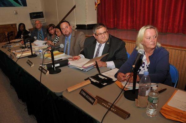 President Donna Hochman, right, with Superintendent Daniel Giordano,