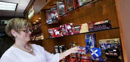 Erika Harlow, customer service, arranges the shelves at
