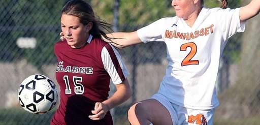 Clarke's Madeline Anderson works against Manhasset's Erin Barry