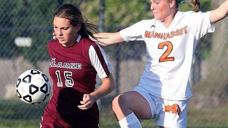 Clarke's Madeline Anderson works against Manhasset's Erin Barry