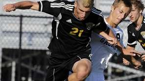 Commack's Peter Lopes battles for control of the