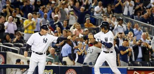 Derek Jeter of the Yankees celebrates his sixth-inning