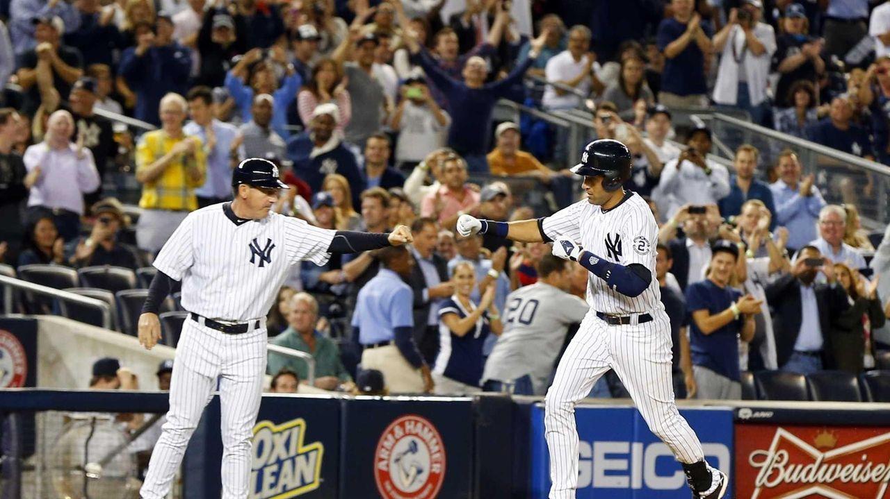 Derek Jeter of the Yankees celebrates his sixth-inning