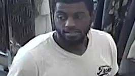Surveillance photo shows one of three suspects wanted