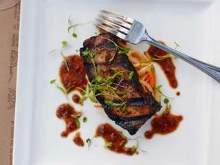 Rich, crisp, jerked pork belly is served with