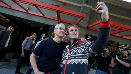 An iPhone fan snaps a selfie with Apple