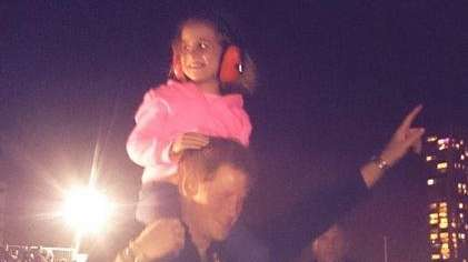 Prince Harry hoisted 5-year-old Isabelle Nixon onto his