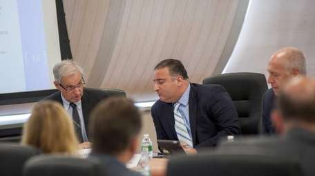 LIPA Chief Operating Officer, John McMahon, left, and