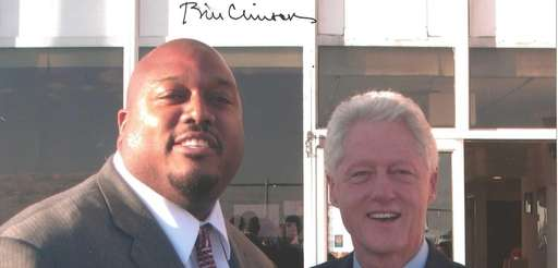 Corey Swinson and former President Bill Clinton in