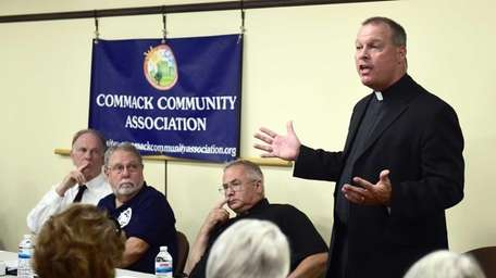 Rev. Marc Herbst speaks to the community during