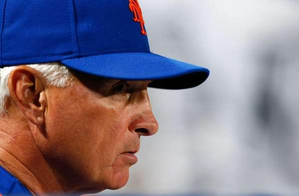 Terry Collins #10 of the Mets looks on