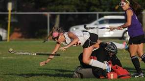 Babylon's No. 12 Rori Sutkowski, left, flies through