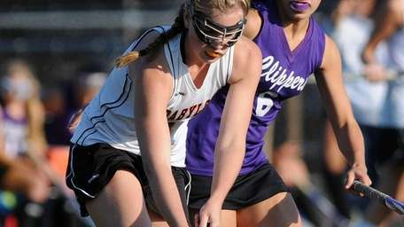 Babylon's Clare McCaffrey, left, gets pressured by Greenport-Southhold's