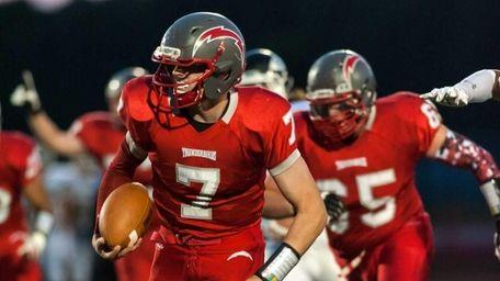 Connetquot quarterback Jack Cassidy runs for a touchdown