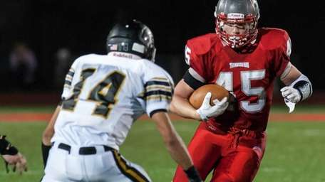 Sachem North linebacker Vinny Valente, left, tries to