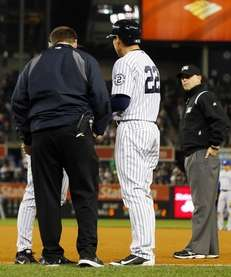 Jacoby Ellsbury #22 of the Yankees is checked