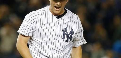Adam Warren #43 of the Yankees reacts after