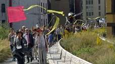 A procession celebrating the new High Line at