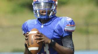 Malverne quarterback Bryce Todd looks to pass during